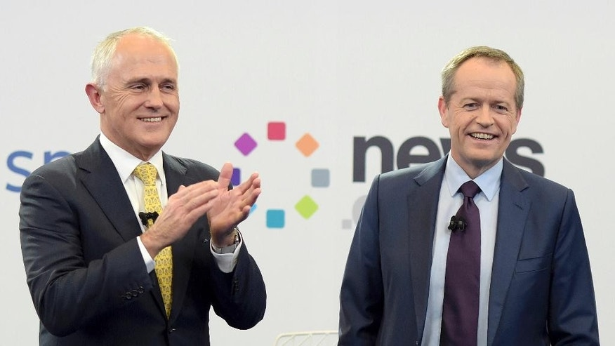 FILE - In this June 17, 2016, file photo, Australia's Prime Minister Malcolm Turnbull, left, and opposition leader Bill Shorten stand together at the end of a debate hosted by Facebook Australia and News.com.au in Sydney, Australia. Australians go to the polls Saturday, July 2, 2016, with the opposition leader vying to become the country's fifth prime minister in three years. (Lukas Coch/Pool Photo via AP)