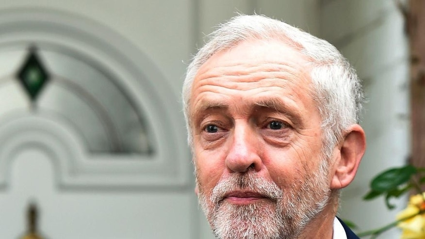 Labour Party leader Jeremy Corbyn leaves his home in north London, Wednesday June 29, 2016.  Corbyn is expected to face a leadership challenge, but says he won't resign despite a vote of no confidence from his party's lawmakers. (Lauren Hurley / PA via AP) UNITED KINGDOM OUT - NO SALES - NO ARCHIVES