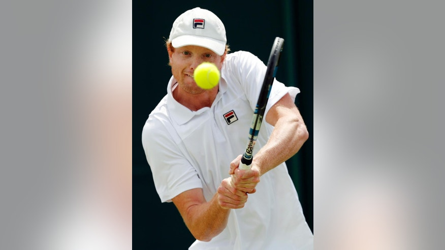 Matthew Barton of Australia returns to Albano Olivetti of France during their men's singles match on day four of the Wimbledon Tennis Championships in London, Thursday, June 30, 2016. (AP Photo/Ben Curtis)