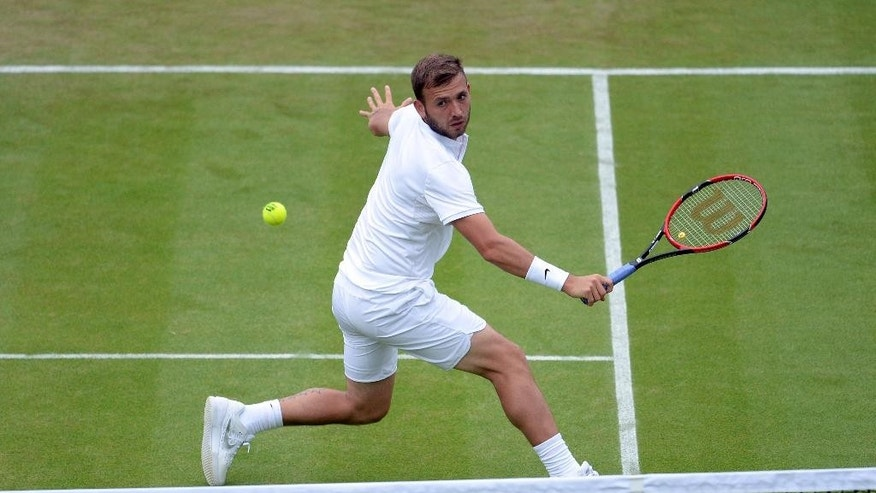 England's Dan Evans returns the ball to Alexandr Dolgopolov of Ukraine during their men's singles match on day three of the Wimbledon Tennis Championships in London, Wednesday, June 29, 2016. (Anthony Devlin/PA via AP) UNITED KINGDOM OUT