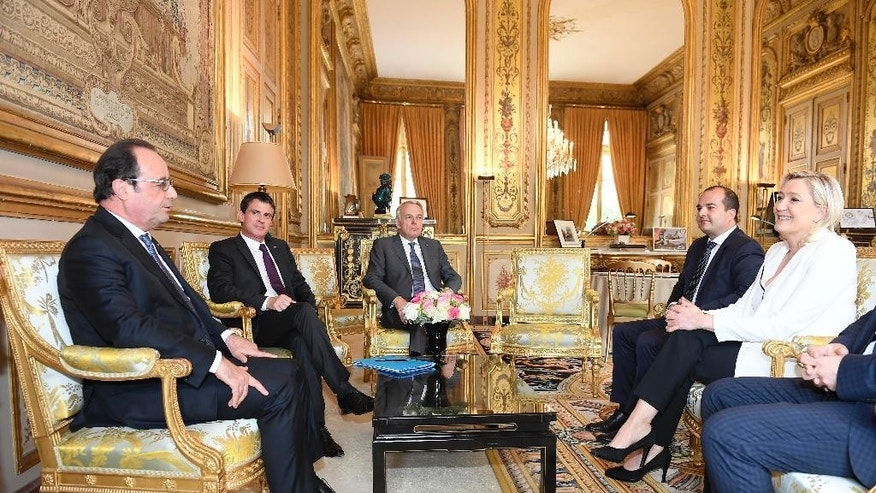From letf, French President Francois Hollande, Prime Minister Manuel Valls and Foreign Minister Jean Marc Ayrault meet French far-right leader Marine Le Pen, right, at the Elysee Palace in Paris, Saturday, June 25, 2016. France's President Francois Hollande is holding exceptional meetings with the leaders of France's political parties as EU leaders try to keep the union together after Britain's vote to leave the EU. (Christophe Saidi, Pool Photo via AP)
