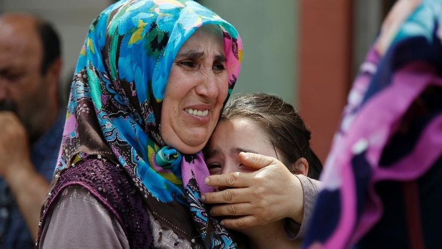 Family members of victims cry outside the Forensic Medical Center in Istanbul, Wednesday, June 29, 2016. Suicide attackers killed dozens at Istanbul's busy Ataturk Airport late Tuesday, the latest in a series of bombings to strike Turkey in recent months. (AP Photo/Emrah Gurel) TURKEY OUT