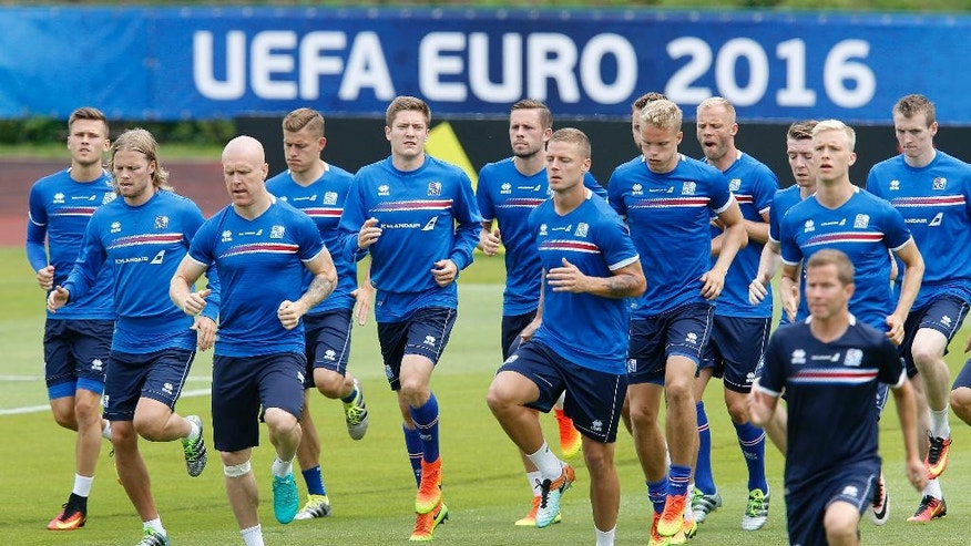 Players attend a training session of Iceland's national soccer team at their base camp in Annecy, France, Thursday, June 30, 2016. Iceland will face France in a Euro 2016 quarterfinal match in Paris on Sunday, July 3, 2016.(AP Photo/Michael Probst)