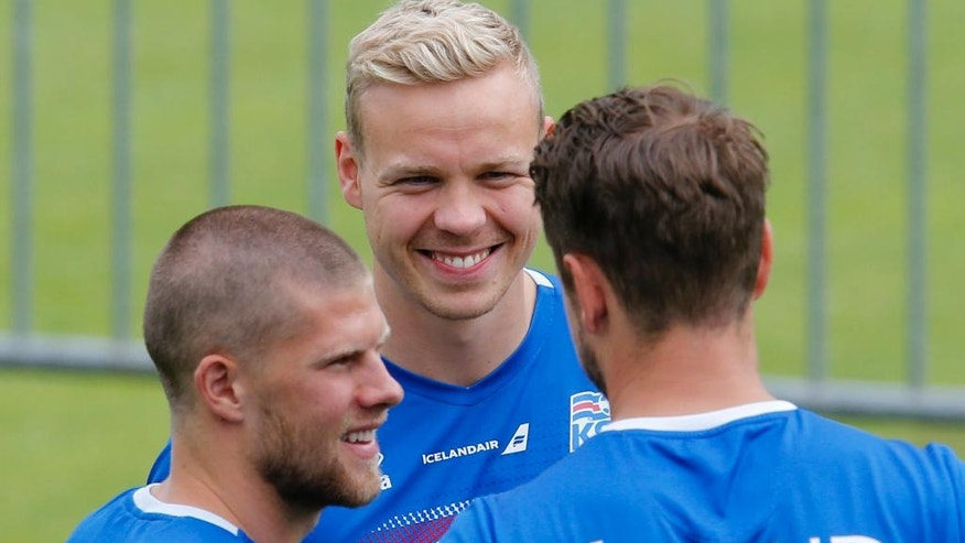 Johann Berg Gudmundsson, Kolbeinn Sigthorsson and Kari Arnason, from left, attend a training session of Iceland's national soccer team at their base camp in Annecy, France, Thursday, June 30, 2016. Iceland will face France in a Euro 2016 quarterfinal match in Paris on Sunday, July 3, 2016.(AP Photo/Michael Probst)