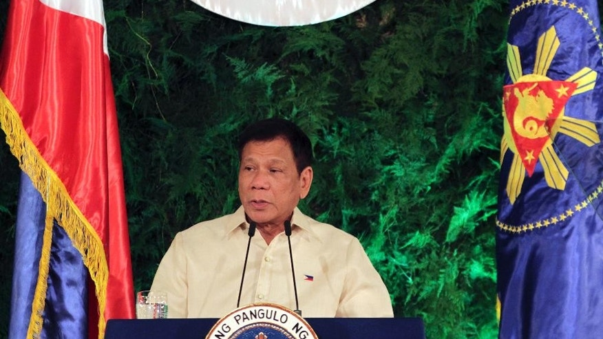 In this photo provided by the News and Information Bureau, Malacanang Palace,  new Philippine President Rodrigo Duterte delivers his inaugural speech after taking his oath at his inauguration ceremony in Malacanang Palace Thursday, June 30, 2016 in Manila, Philippines. Duterte becomes the 16th President of the Philippine Republic. (The News and Information Bureau, Malacanang Palace via AP)