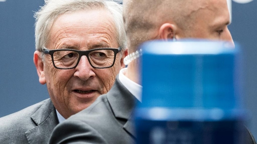 European Commission President Jean-Claude Juncker, left, leaves an EU summit in Brussels on Wednesday, June 29, 2016. European Union leaders are meeting without Britain for the first time since the British referendum to rethink their bloc and keep it from disintegrating after Britain's unprecedented vote to leave. (Geert Vanden Wijngaert)