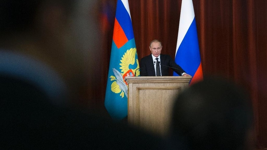 Russian President Vladimir Putin speaks during his meeting with Russian Ambassadors in Moscow, Russia, Thursday, June 30, 2016. Putin said that Russia will respond to NATO's military buildup near its borders, but will not be drawn into an arms race. (AP Photo/Ivan Sekretarev, pool)