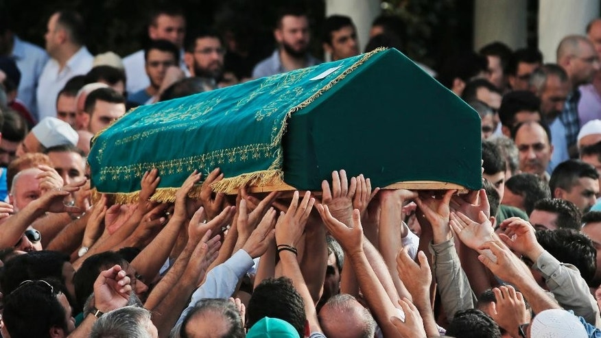 Mourners carry the coffin of Muhammed Eymen Demirci, killed Tuesday at the blasts in Istanbul's Ataturk airport, during the funeral in Istanbul's Basaksehir neighbourhood, Wednesday, June 29, 2016. Demirci was 25 years old and worked for ground services at the airport. Suicide attackers killed dozens and wounded scores of others at the busy airport late Tuesday, the latest in a series of bombings to strike Turkey in recent months. Turkish authorities have banned distribution of images relating to the Ataturk airport attack within Turkey. (AP Photo/Lefteris Pitarakis) TURKEY OUT