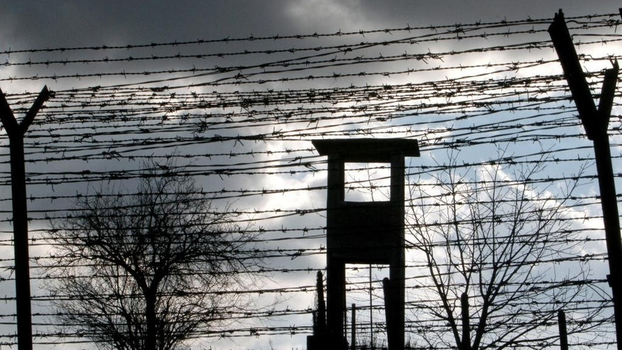 FILE - In this file photo taken Dec. 10, 2010, a bird flies above a guard tower in Fort 13 of the Jilava jail where numerous political prisoners were held and executed, in Jilava, Romania. A government institute tasked with investigating communist crimes has called for two former prison chiefs to be probed on suspicion of causing the deaths of 204 political prisoners.(AP Photo/Vadim Ghirda, File)