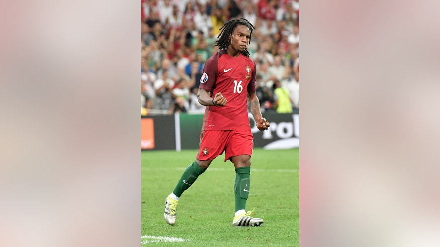 Portugal's Renato Sanches celebrates after scoring during the penalty shootout of the Euro 2016 quarterfinal soccer match between Poland and Portugal, at the Velodrome stadium in Marseille, France, Thursday, June 30, 2016. (AP Photo/Martin Meissner)