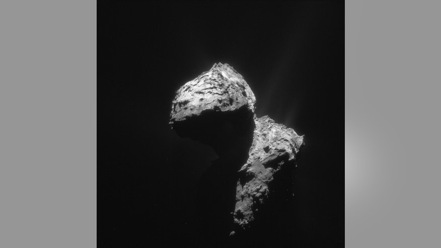 A single frame enhanced NavCam image provided by European Space Agency, ESA, and  taken on 7 January 2016, when Rosetta was 74.1 km from the nucleus of Comet 67P/Churyumov-Gerasimenko. The scale is 6.3 m/pixel and the image measures 6.5 km across. After a journey lasting 12 years, a date has been set for the Rosetta spacecraft's final descent onto comet 67P/Churyumov-Gerasimenko. The European Space Agency says the probe will crash onto the comet Sept. 30, joining its sidekick Philae. The lander touched down nearly two years ago. (ESA/ Rosetta/NAVCAM via AP)
