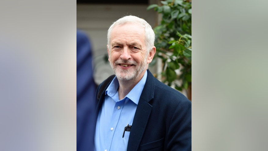 Britain's Labour Party leader Jeremy Corbyn smiles as he leaves his home in north London, Thursday June 30, 2016. The opposition Labour Party is in  disarray, with leader Jeremy Corbyn facing intense pressure to resign after losing a confidence vote. He has lost the support of the party's lawmakers but claims the rank and file still back him. (Lauren Hurley/PA via AP)