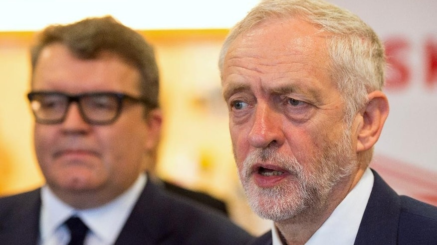 Labour Leader Jeremy Corbyn, right, speaks to the media as Labour Deputy Leader Tom Watson watches, during a visit to the Polish Social Cultural Association in Hammersmith, west London, Wednesday June 29, 2016. (Dominic Lipinski/PA via AP) UNITED KINGDOM OUT