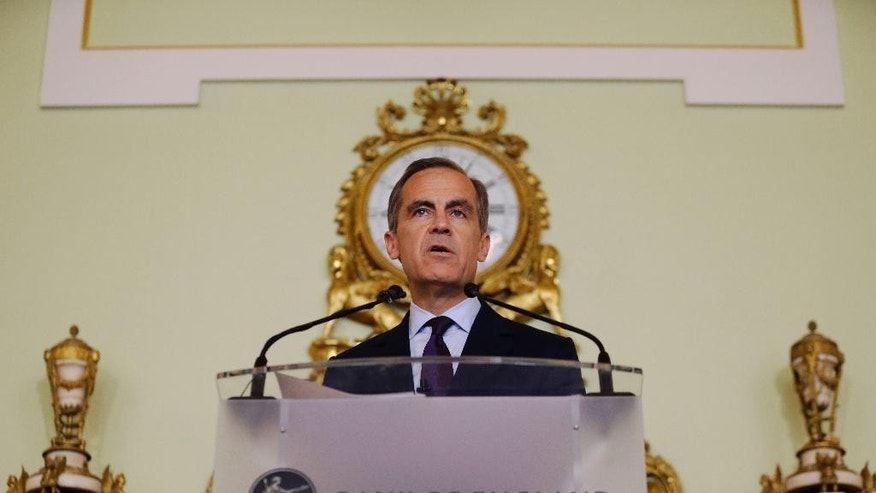 The governor of the Bank of England Mark Carney gives a press conference, his first since the leave result of the European Union referendum, at the Bank of England in the City of London, Thursday, June 30, 2016. Carney says the uncertainty over Britain's exit from the European Union means the central bank will likely have to provide monetary stimulus this summer.  (AP Photo/Matt Dunham, Pool)