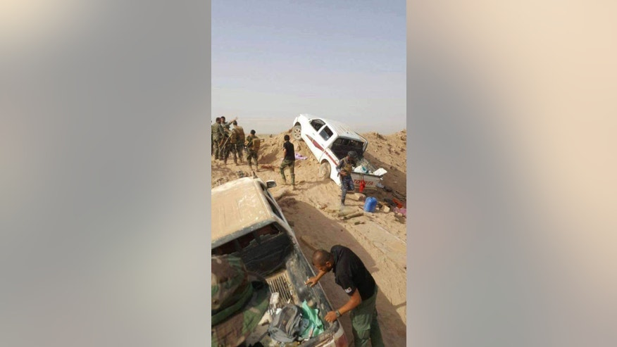 This image released by Iraq's Counterterrorism Service shows militant vehicles after Coalition and Iraqi security forces targeted a convoy of Islamic State fighters fleeing the outskirts of Fallujah, Iraq on Wednesday, June 29, 2016. Iraq's Defense Ministry has released footage showing airstrikes on dozens of vehicles, which officials said was an IS convoy fleeing the western city of Fallujah following its recapture by the Iraqi military.(Iraq Counterterrorism Service via AP)