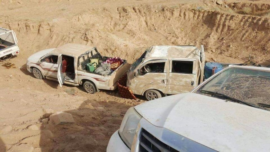 This image released by Iraq's Counterterrorism Service shows militant vehicles after airstrikes on a convoy of Islamic State fighters fleeing the outskirts of Fallujah, Iraq on Wednesday, June 29, 2016. Iraq's Defense Ministry has released footage showing airstrikes on dozens of vehicles, which officials said was an IS convoy fleeing the western city of Fallujah following its recapture by the Iraqi military. (Iraq Counterterrorism Service via AP)