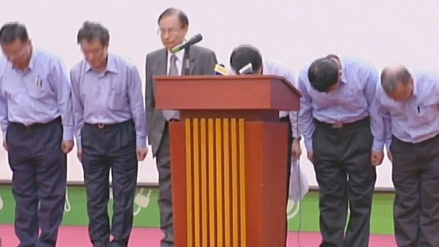 In this Tuesday, June 28, 2016, image made from video provided by Vietnam's VTV, chairman of Taiwan's Formosa steel plant Chen Yuan Cheng, third from left, and company officials bow as a gesture of apology in Hanoi, Vietnam. Vietnam's government announced Thursday that a Taiwanese-owned steel plant was responsible for massive fish deaths along the central Vietnamese coast and said it has pledged to pay $500 million in compensation. (VTV via AP Video)