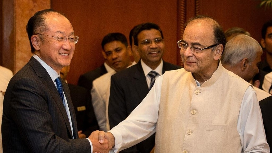 Indian Finance Minister Arun Jaitley, right, shakes hand with World Bank President Jim Yong Kim, in New Delhi, India, Thursday, June 30, 2016. The World Bank Group Thursday signed an agreement with the International Solar Alliance, consisting of 121 countries led by India, to collaborate on increasing solar energy use around the world, with the goal of mobilizing $1 trillion in investment by 2030. (AP Photo/Manish Swarup)