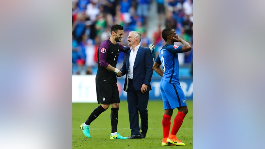 France coach Didier Deschamps celebrates with France goalkeeper Hugo Lloris, left, celebrates at the end of the Euro 2016 round of 16 soccer match between France and Ireland, at the Grand Stade in Decines-­Charpieu, near Lyon, France, Sunday, June 26, 2016. (AP Photo/Thanassis Stavrakis)