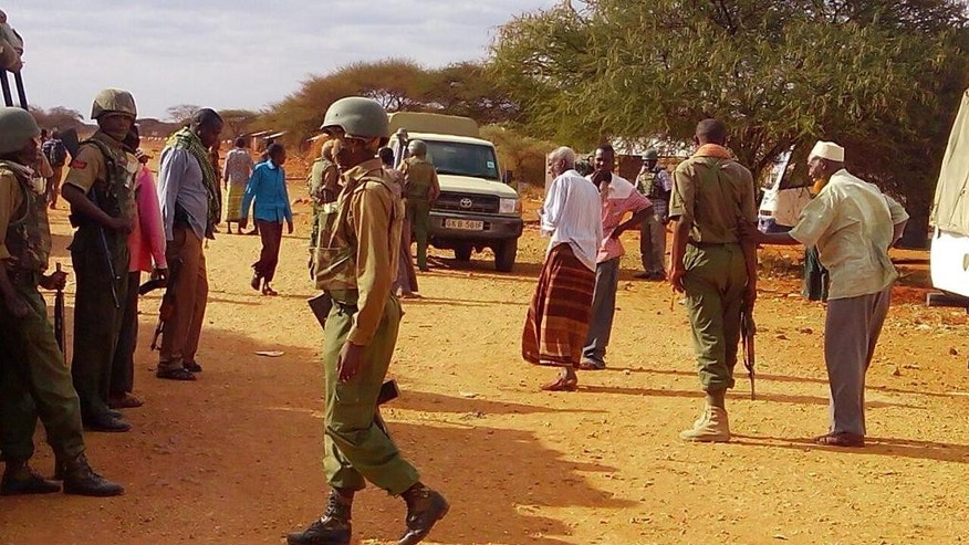 EDS NOTE : Photos taken with mobile phone---Kenya army soldiers patrol at street in Mandera, Kenya, Friday July 1, 2016, after gunmen, thought to be from the al-Shabab group according to a Kenyan official, killed at least six people when they shot at two buses traveling in northern Kenya.  U.S. government issued a travel warning for U.S. citizens to avoid going to Kenya's border with Somalia. (AP Photo)(AP Photo)