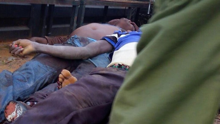 EDS NOTE Photos taken with mobile phone--- The bodies of bus passengers lie in the police truck, in Mandera, Kenya, Friday July 1, 2016, after gunmen, thought to be from the al-Shabab group according to a Kenyan official, killed at least six people when they shot at two buses traveling in northern Kenya.  U.S. government issued a travel warning for U.S. citizens to avoid going to Kenya's border with Somalia. (AP Photo)