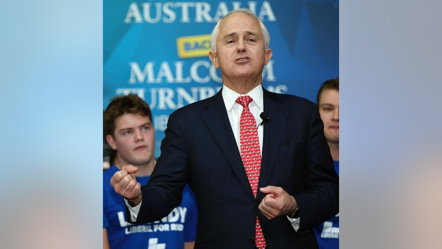 Australia's Prime Minister Malcolm Turnbull raises speaks to the media during his visit to a small business factory in the western suburbs of Sydney, Australia, Friday, July 1, 2016. Australians go to the polls Saturday with the opposition leader vying to become the country's fifth prime minister in three years.  (AP Photo/Rob Griffith)