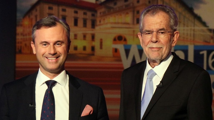 FILE - In this May 19, 2016 file picture Norbert Hofer of Austria's Freedom Party, FPOE, left, and Alexander Van der Bellen, candidate of the Austrian Greens, wait for the start of a TV debate in Vienna, Austria. An Austrian court on Friday  July 1, 2016  overturned the  presidential election result and called for  rerun. (AP Photo/Ronald Zak,file)