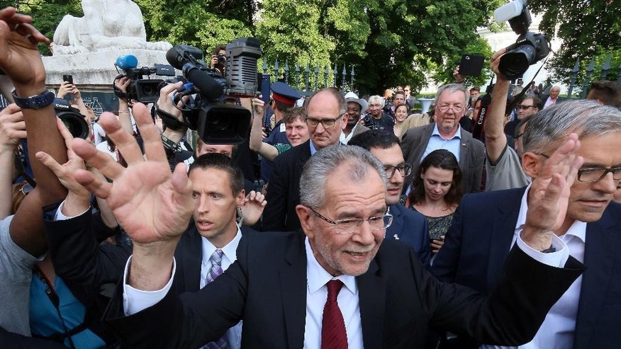 FILE - In this May 23, 2016 file picture Alexander Van der Bellen winner of Austria's presidential election waves to his supporters in Vienna, Austria.  Austria's highest court ruled Friday July 1, 2016  that presidential elections narrowly lost by a right-wing candidate must be repeated after his party claimed gross irregularities in the absentee vote count.  (AP Photo/Ronald Zak,file)