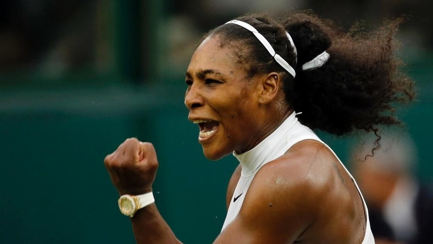 Serena Williams of the U.S celebrates after beating Christina McHale of the U.S in their women's singles match on day five of the Wimbledon Tennis Championships in London, Friday, July 1, 2016. (AP Photo/Ben Curtis)