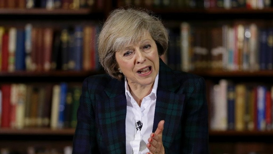 Britain's Home Secretary Theresa May launches her leadership bid for Britain's ruling Conservative Party in London, Thursday, June 30, 2016. The battle to succeed Prime Minister David Cameron as Conservative Party leader has drawn strong contenders with the winner set to become prime minister and play a vital role in shaping Britain's future relationship with the European Union. (AP Photo/Matt Dunham)
