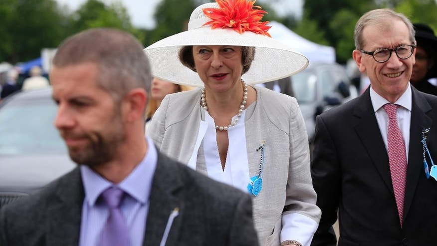 Britain's Home Secretary Theresa May attends day three of the 2016 Henley Rowing Royal Regatta in Henley, England, Friday, July 1, 2016. (Jonathan Brady/PA via AP)