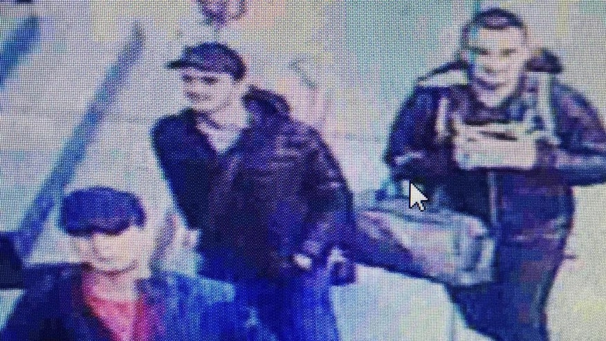 THIS IS A RECROPPED VERSION OF XLP801 TRANSMITTED THURSDAY  JUNE 30, 2016  n this framegrab from CCTV video, made available by the Turkish Haberturk newspaper on Thursday, June 30, 2016, people believed to be the attackers walk in Istanbul's Ataturk airport, Tuesday June 28, 2016. Three attackers carried out a gun-and-suicide bomb attack, killing dozens and wounding scores of others. at the busy airport late Tuesday, the latest in a series of bombings to strike Turkey in recent months. Turkish authorities have banned distribution of images relating to the Ataturk airport attack within Turkey. (Haberturk newspaper via AP Photo)