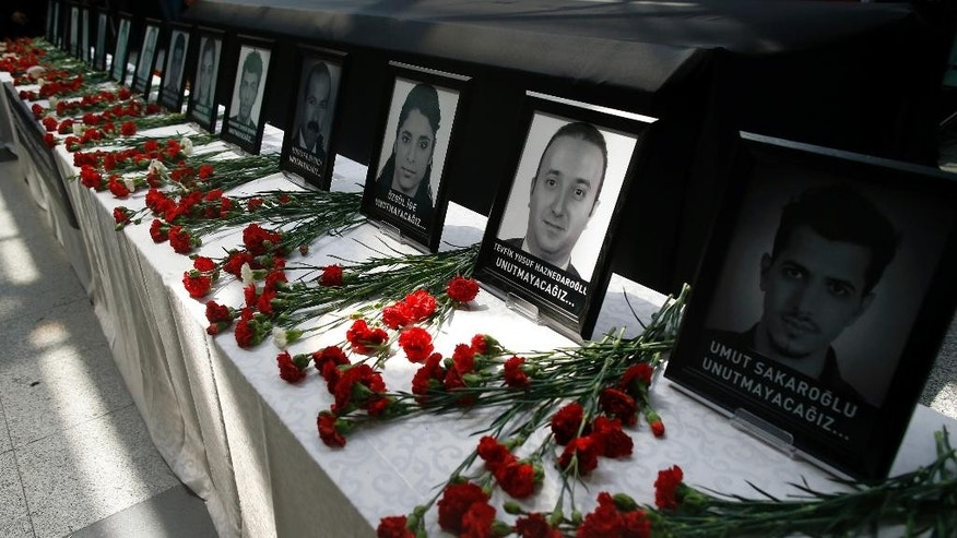 In this Thursday, June 30, 2016 photo, their photographs were displayed as family members, colleagues and friends of the victims of Tuesday blasts gather for a memorial ceremony at the Ataturk Airport in Istanbul. A Chechen extremist masterminded the triple suicide bombing at Istanbul's busiest airport that killed dozens, a U.S. congressman has said. U.S. Rep. Michael McCaul, chairman of the House Committee on Homeland Security, told CNN that Akhmed Chatayev directed Tuesday night's gun-and-bomb attack at Ataturk Airport, one of the world's busiest, which also wounded over 200 other people. Turkish authorities have banned distribution of images relating to the Ataturk airport attack within Turkey.(AP Photo/Emrah Gurel)