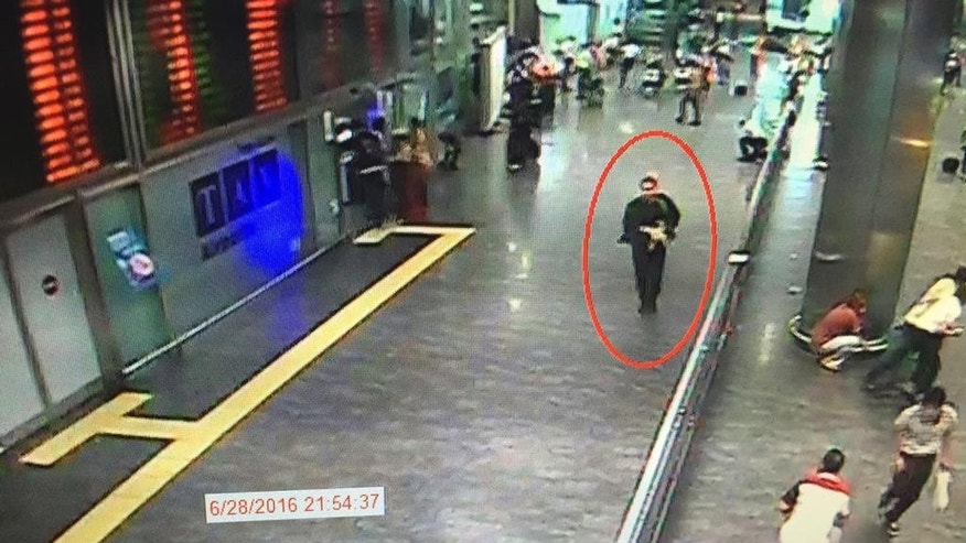 In this framegrab from CCTV video, made available by the Turkish Haberturk newspaper on Thursday, June 30, 2016, a man, circled, believed to be one of the attackers walks in Istanbul's Ataturk airport, Tuesday June 28, 2016. Three attackers carried out a gun-and-suicide bomb attack, killing dozens and wounding scores of others. at the busy airport late Tuesday, the latest in a series of bombings to strike Turkey in recent months. Turkish authorities have banned distribution of images relating to the Ataturk airport attack within Turkey. (Haberturk newspaper via AP Photo)