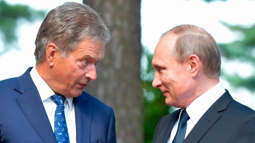 Finnish President Sauli Niinisto, left, and Russian President Vladimir Putin meet at Kultaranta summer residence in Naantali, Finland, Friday, July 1, 2016.  President Vladimir Putin is in Finland on a working visit. (Alexei Druzhinin/Sputnik, Kremlin Pool Photo via AP)