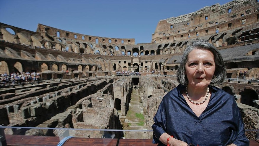Architect Gisella Capponi, who directed the restoration, poses inside the Colosseum after the first stage of the restoration work was completed in Rome, Friday, July 1st, 2016. The Colosseum has emerged more imposing than ever after its most extensive restoration, a multi-million-euro cleaning to remove a dreary, undignified patina of soot and grime from the ancient arena, assailed by pollution in traffic-clogged Rome. (AP Photo/Andrew Medichini)