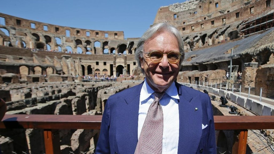 Tod's founder Diego Della Valle, who is paying 25 million euros for the project, poses inside the Colosseum after the first stage of the restoration work was completed in Rome, Friday, July 1st, 2016. The Colosseum has emerged more imposing than ever after its most extensive restoration, a multi-million-euro cleaning to remove a dreary, undignified patina of soot and grime from the ancient arena, assailed by pollution in traffic-clogged Rome. (AP Photo/Andrew Medichini)