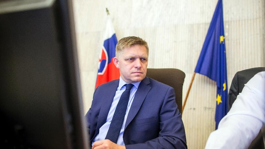 Slovakia's Prime Minister Robert Fico takes his seat during a goverment meeting in Bratislava, Slovakia, Thursday, June 30, 2016.  Slovakia will undertake their six-month presidency of the European Union from July  2016. (AP Photo/Bundas Engler)