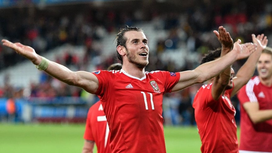Wales' Gareth Bale celebrates at the end of the Euro 2016 quarterfinal soccer match between Wales and Belgium, at the Pierre Mauroy stadium in Villeneuve d'Ascq, near Lille, France, Friday, July 1, 2016. Wales won 3-1. (AP Photo/Martin Meissner)