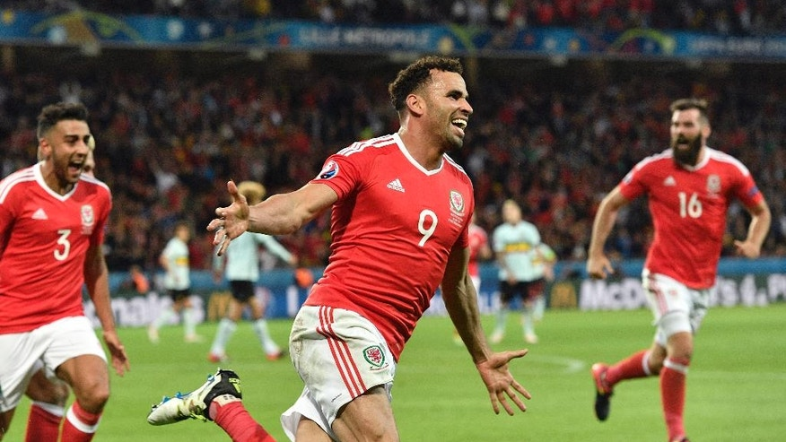 Wales' Hal Robson Kanu, center, celebrates after scoring his side's second goal during the Euro 2016 quarterfinal soccer match between Wales and Belgium, at the Pierre Mauroy stadium in Villeneuve d'Ascq, near Lille, France, Friday, July 1, 2016. (AP Photo/Martin Meissner)