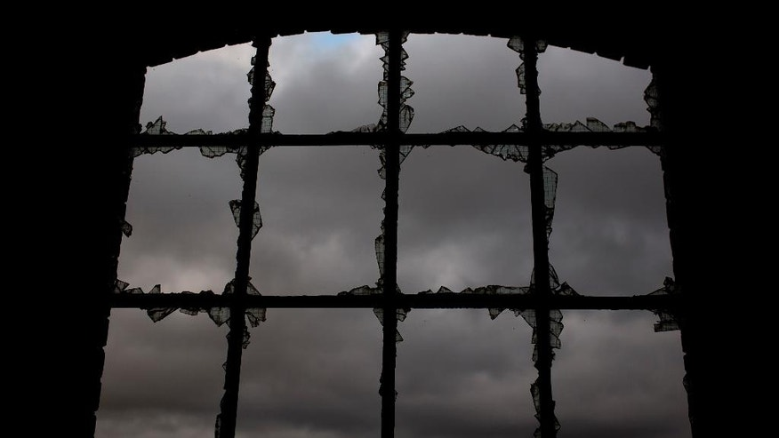 In this Thursday, June 30, 2016 photo, a louring sky is seen through the broken glass of a window, inside the workshop building of the Penallta colliery in Hengoed, South Wales.  Even though Wales receives hundreds of millions annually in EU funding, more than half of the Welsh electorate voted in last week's referendum for Britain to leave the EU, and maybe the heavy industry which once provided thousands of jobs will never return to Wales.(AP Photo/Emilio Morenatti)