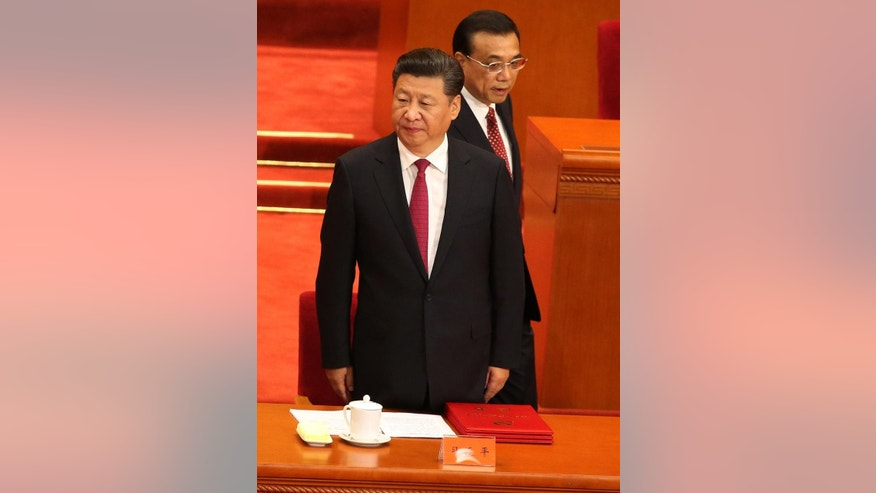 Chinese President Xi Jinping, front, and Premier Li Keqiang arrive for a ceremony to mark the 95th anniversary of the founding of the Communist Party of China at the Great Hall of the People in Beijing, Friday, July 1, 2016. (How Hwee Young/Pool Photo via AP)