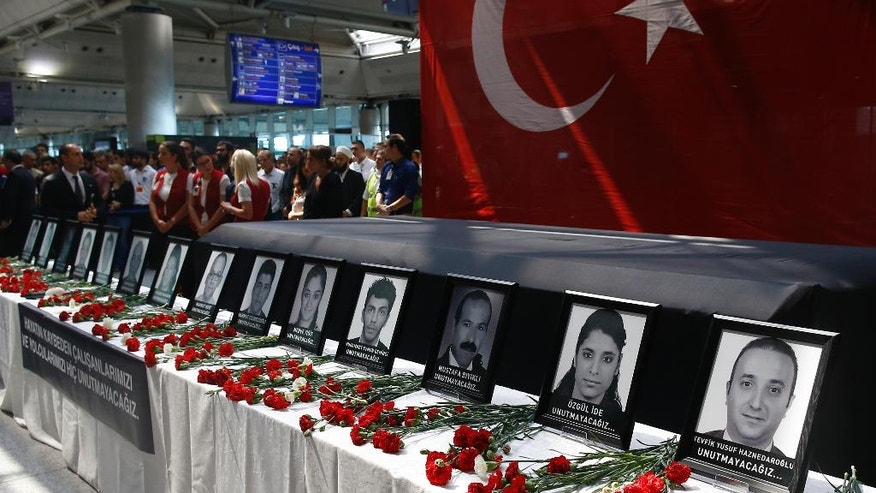 In this Thursday, June 30, 2016 photo, family members, colleagues and friends of the victims of Tuesday blasts gather for a memorial ceremony at the Ataturk Airport in Istanbul. A Chechen extremist masterminded the triple suicide bombing at Istanbul's busiest airport that killed dozens, a U.S. congressman has said. U.S. Rep. Michael McCaul, chairman of the House Committee on Homeland Security, told CNN that Akhmed Chatayev directed Tuesday night's gun-and-bomb attack at Ataturk Airport, one of the world's busiest, which also wounded over 200 other people. Turkish authorities have banned distribution of images relating to the Ataturk airport attack within Turkey.(AP Photo/Emrah Gurel)