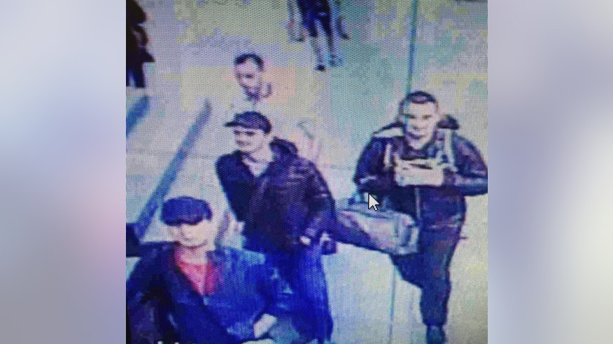 THIS ADDS THAT THE MAN WEARING WHITE IN THE BACKGROUND UNRELATED TO THE ATTACK In this framegrab from CCTV video, made available by the Turkish Haberturk newspaper on Thursday, June 30, 2016,  3 people in foreground  believed to be the attackers as man unrelated to the attack passes in the background, walk in Istanbul's Ataturk airport, Tuesday June 28, 2016. Three attackers carried out a gun-and-suicide bomb attack, killing dozens and wounding scores of others. at the busy airport late Tuesday, the latest in a series of bombings to strike Turkey in recent months. Turkish authorities have banned distribution of images relating to the Ataturk airport attack within Turkey. (Haberturk newspaper via AP Photo)