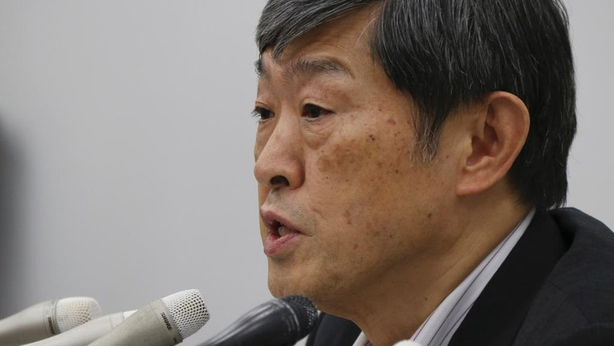 Japan International Cooperation Agency President Shinichi Kitaoka answers reporters questions during a press conference following the incident at a Bangladesh restaurant, in Tokyo, Saturday, July 2, 2016. Shinichi Kitaoka said one Japanese hostage has been hospitalized, and the fate of seven others remains unknown. They were outside consultants working for Japan's development agency on an infrastructure project. (AP Photo/Koji Sasahara)