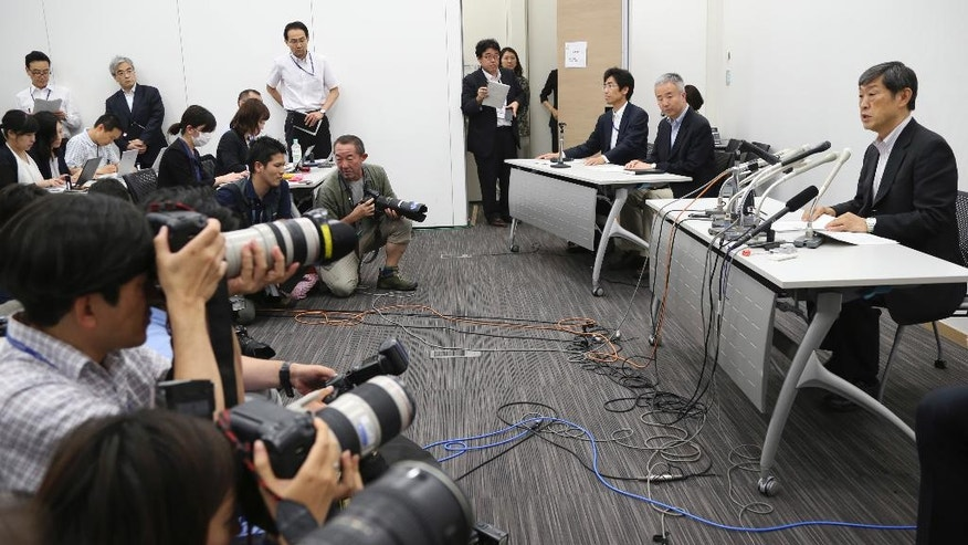 Japan International Cooperation Agency President Shinichi Kitaoka, right, speaks during a press conference following an incident at a Bangladesh restaurant attack in Tokyo, Saturday, July 2, 2016. Shinichi Kitaoka said One Japanese hostage has been hospitalized, and the fate of seven others remains unknown. They were outside consultants working for Japan's development agency on an infrastructure project. (AP Photo/Koji Sasahara)