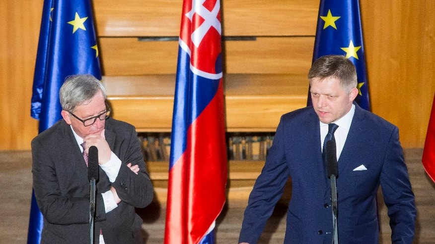 Slovakia's Prime Minister Robert Fico, right, speaks,  during an informal meeting with President of the European commission Jean-Claude Juncker, left, prior to a dinner hosted by Robert Fico at Bratislava Castle, Slovakia, Thursday, June 30, 2016. Slovakia takes over the European Union's presidency on Friday determined to help reconnect the EU with its citizens and put decision-making back in the hands of Europe's nations as the bloc reels from Britain's vote to leave. (AP Photo/Bundas Engler)