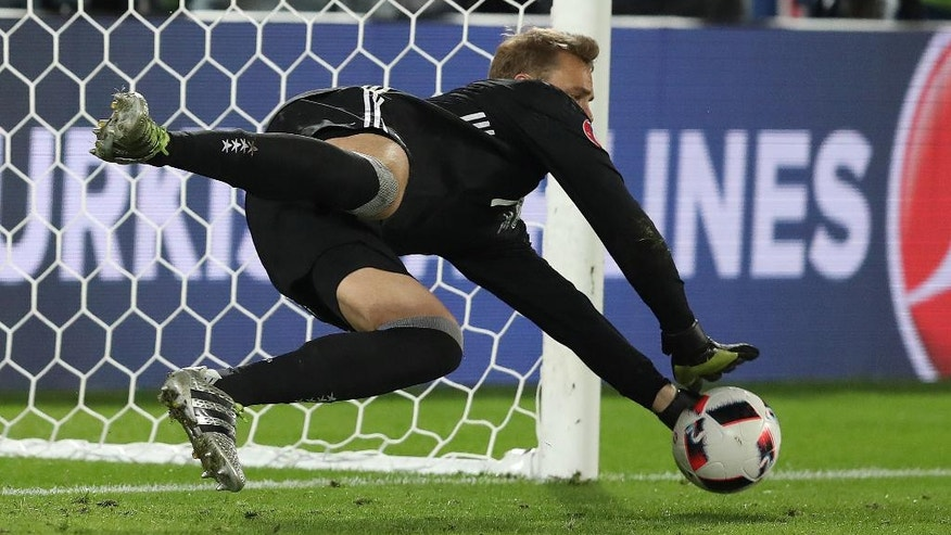 Germany goalkeeper Manuel Neuer makes a safe during the Euro 2016 quarterfinal soccer match between Germany and Italy, at the Nouveau Stade in Bordeaux, France, Saturday, July 2, 2016. (AP Photo/Thanassis Stavrakis)