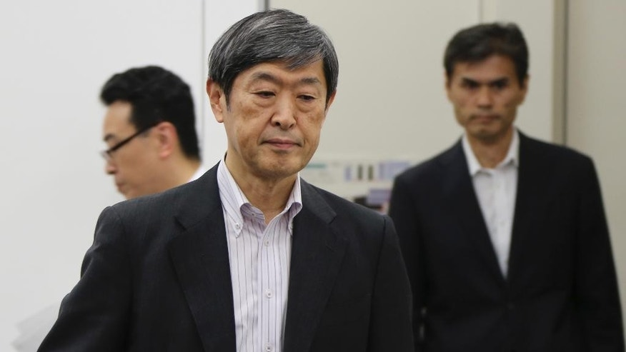 Japan International Cooperation Agency President Shinichi Kitaoka arrives for a press conference following the incident at  Bangladesh restaurant in Tokyo, Saturday, July 2, 2016. Shinichi Kitaoka said one Japanese hostage has been hospitalized, and the fate of seven others remains unknown. They were outside consultants working for Japan's development agency on an infrastructure project. (AP Photo/Koji Sasahara)
