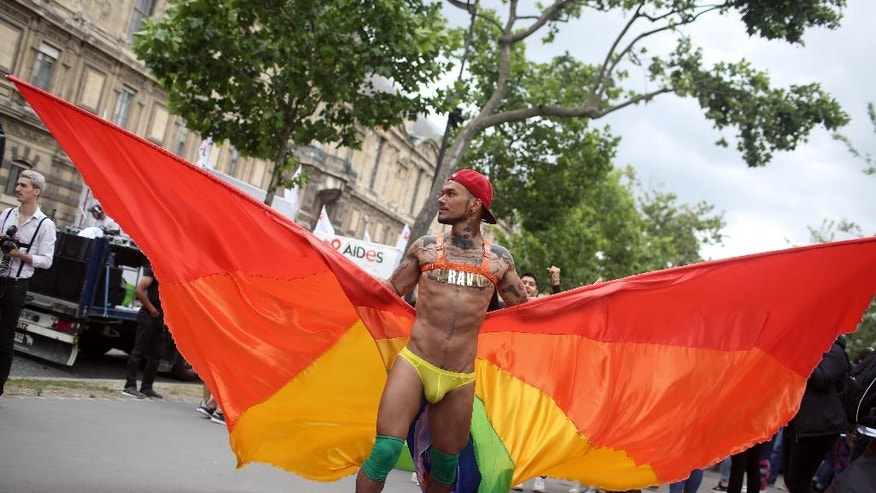 A reveler parades during the annual Gay Pride march in Paris, France, Saturday, July 2, 2016. Three weeks after the massacre at a Florida gay nightclub, people celebrate gay rights movement. (AP Photo/Thibault Camus)